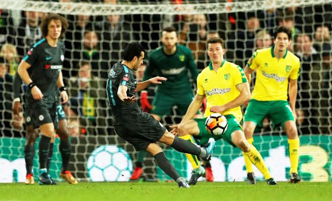 Chelsea's Pedro shoots at goal durng their match against Norwich City at Carrow Road at Norwich
