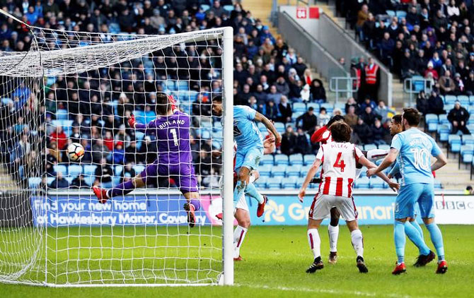 Coventry City's Jordan Willis scores their first goal against Stoke City at Ricoh Arena in Coventry