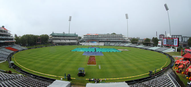 The pitch at the Newlands Cricket Ground is kept under covers as rains lash Cape Town on Sunday