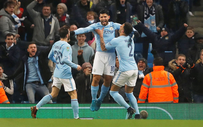 Manchester City's Sergio Aguero celebrates with teammates on heading in the winner of the League Cup semi-final first leg against Bristol City at Etihad Stadium on Tuesday