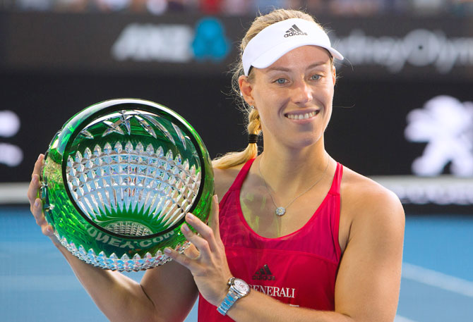 Germany's Angelique Kerber holds the trophy after winning the Sydney International final against Australia's Ashleigh Barty at Sydnet Olympic Park on Saturday