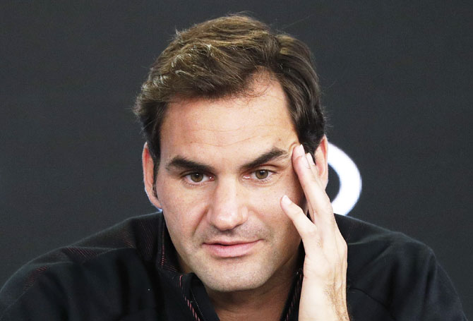 Australian Open defending champion Roger Federer speaks at a news conference before the Australian Open tennis tournament on Sunday