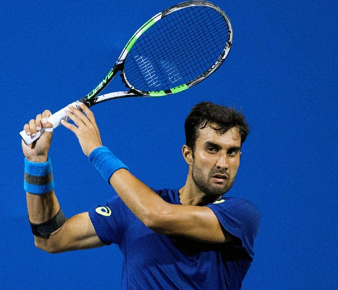 Rediff Sports - Cricket, Indian hockey, Tennis, Football, Chess, Golf - Bhambri qualifies for Aus Open, to face Baghdatis in opener
