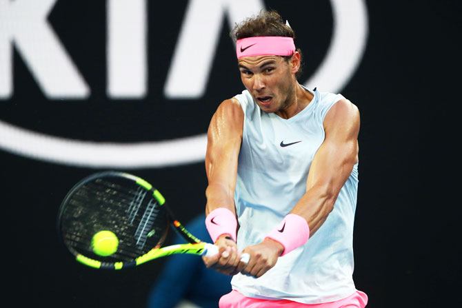 Rediff Sports - Cricket, Indian hockey, Tennis, Football, Chess, Golf - Fans swoon as sleeveless Nadal turns up the heat in Melbourne!