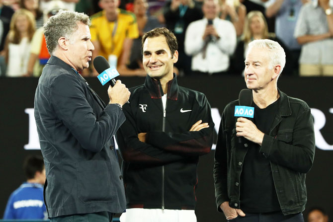 Hollywood actor and comedian Will Ferrell (left) and John McEnroe (right) interview Roger Federer after winning his first round match against Aljaz Bedene on Day 2 of the 2018 Australian Open at Melbourne Park in Melbourne on Tuesday