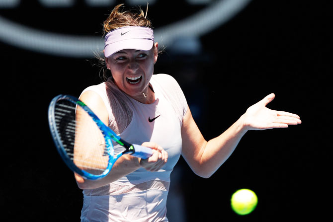 Rediff Sports - Cricket, Indian hockey, Tennis, Football, Chess, Golf - PIX: Sharapova sizzles in scorching Melbourne to reach 3rd round