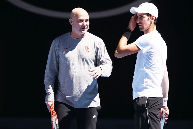 Rediff Sports - Cricket, Indian hockey, Tennis, Football, Chess, Golf - Physically extraordinary Djokovic is battle ready, asserts coach Agassi