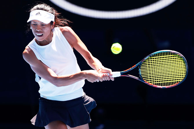 Su-Wei Hsieh plays a backhand in her fourth round match against Angelique Kerber