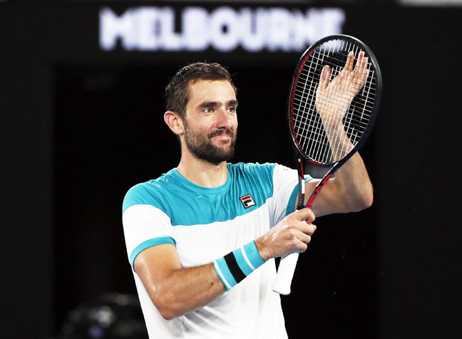Croatia's Marin Cilic celebrates winning his match against Britain's Kyle Edmund during their Australian Open semi-final at the Rod Laver Arena in Melbourne on Thursday