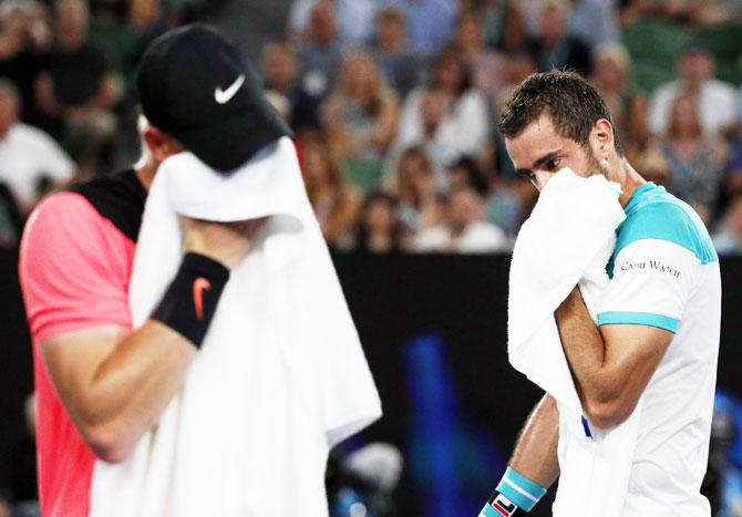 The heat took a toll on both, Kyle Edmund and Marin Cilic