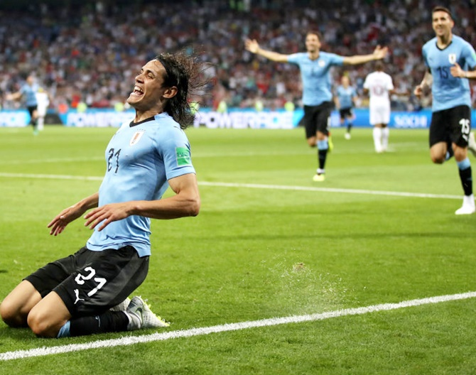 Edinson Cavani celebrates after putting Uruguay ahead in the World Cup Round of 16 match against Portugal. Photograph: Julian Finney/Getty Images