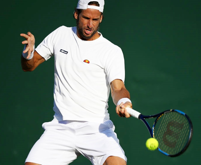 Feliciano Lopez of Spain plays a forehand