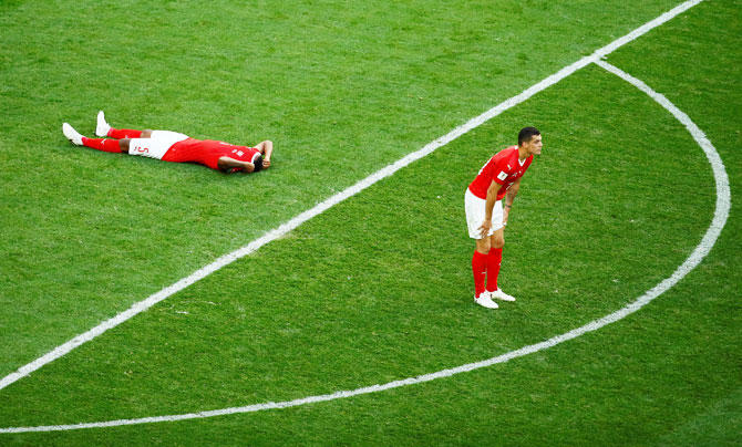 Switzerland's Manuel Akanji and Granit Xhaka look dejected at the end of the match