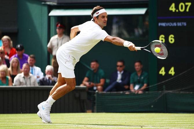 Roger Federer returns against Lukas Lacko