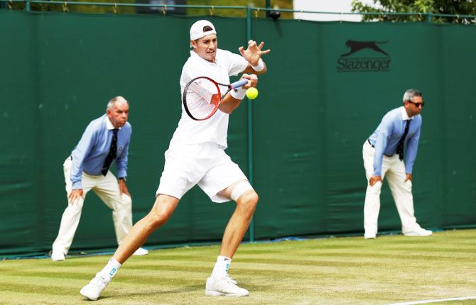 USA's John Isner in action during the second round match against Belgium's Ruben Bemelmans