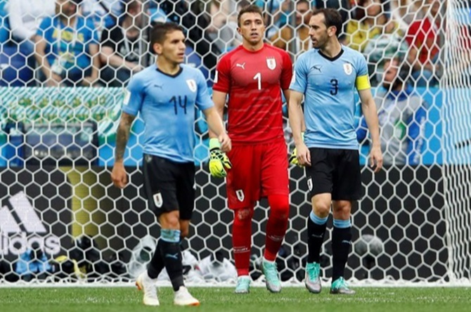 Uruguay's Diego Godin, right, during the quarter-final against France. Photograph: Jason Cairnduff/Reuters
