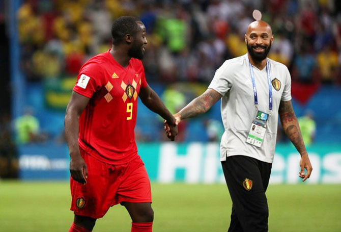 Belgium's Romelu Lukaku celebrates with assistant coach Thierry Henry after their win over Brazil on Friday
