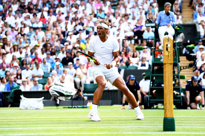 Spain's Rafael Nadal celebrates a point against the Czech Republic's Jiri Vesely during their fourth round match on day seven of the Wimbledon Lawn Tennis Championships at All England Lawn Tennis and Croquet Club in London on Monday
