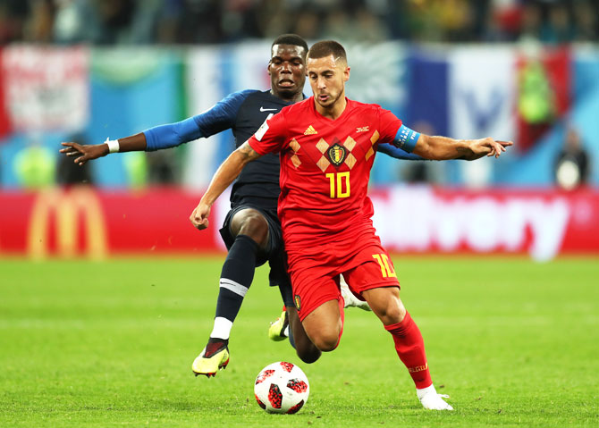 France's Paul Pogba challenges Belgium's Eden Hazard as they vie for possession