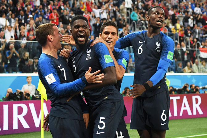 France's Samuel Umtiti celebrates with teammates after heading in the first goal, that eventually proved to be the match-winning goal, during the 2018 FIFA World Cup semi-final against Belgium at Saint Petersburg Stadium in Saint Petersburg, Russia, on Tuesday