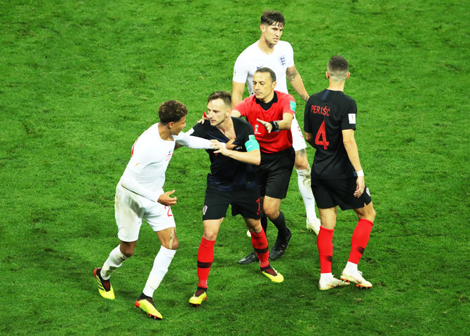 Croatia's Ivan Rakitic (right) is restrained by the referee as he gets into a scuffle with England's Dele Alli