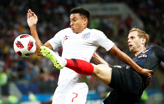 England's Jesse Lingard hold off Croatia's Ivan Strinic as they vie for possession