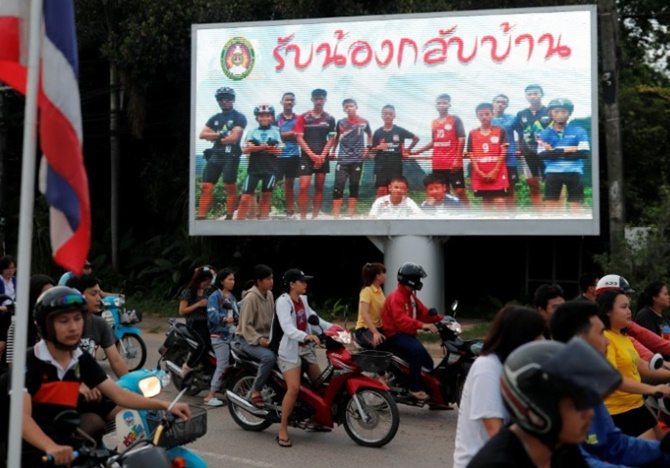 Rediff Sports - Cricket, Indian hockey, Tennis, Football, Chess, Golf - World soccer toasts Thai cave boys' rescue