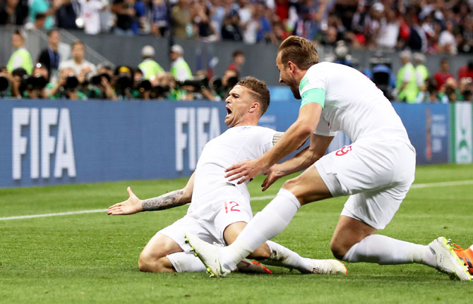 England's Kieran Trippier celebrates with teammate Harry Kane after scoring their opening goal