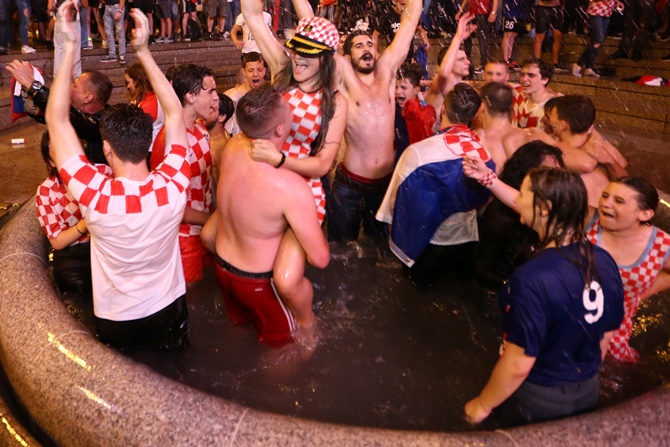 Rediff Sports - Cricket, Indian hockey, Tennis, Football, Chess, Golf - PHOTOS: Jubilant Croatia fans revel in World Cup semis win over England
