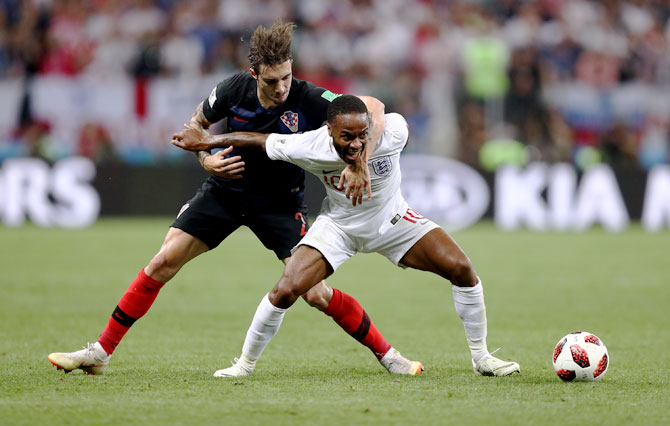 Croatia's Sime Vrsaljko challenges England's Raheem Sterling during the FIFA World Cup semi-final on Wednesday