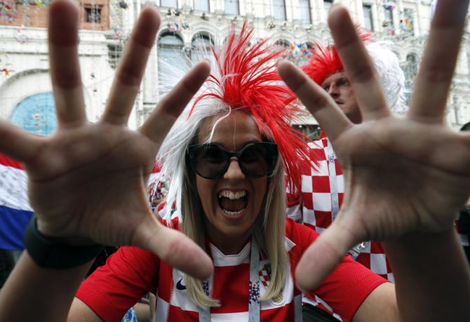 Rediff Sports - Cricket, Indian hockey, Tennis, Football, Chess, Golf - PIX: Croatia fans eclipse low-key French in Moscow