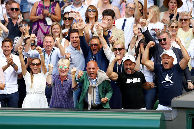 Novak Djokovic's team erupts in celebration after his win