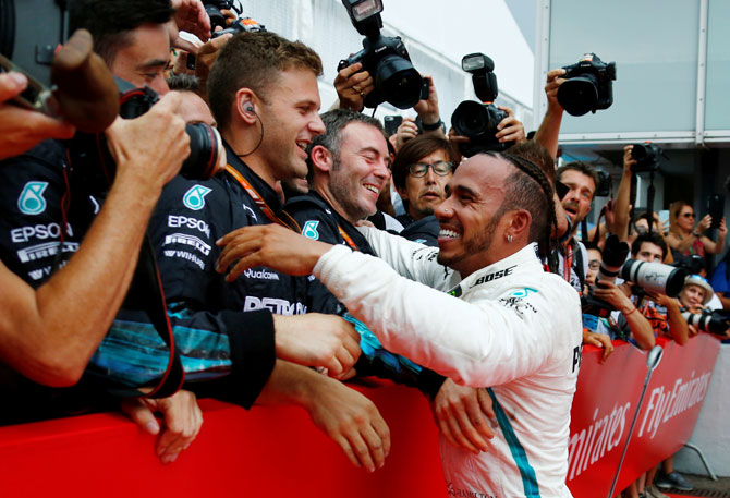 Mercedes' Lewis Hamilton celebrates winning the German GP race with team members at Hockenheimring, Hockenheim, in Germany on Sunday