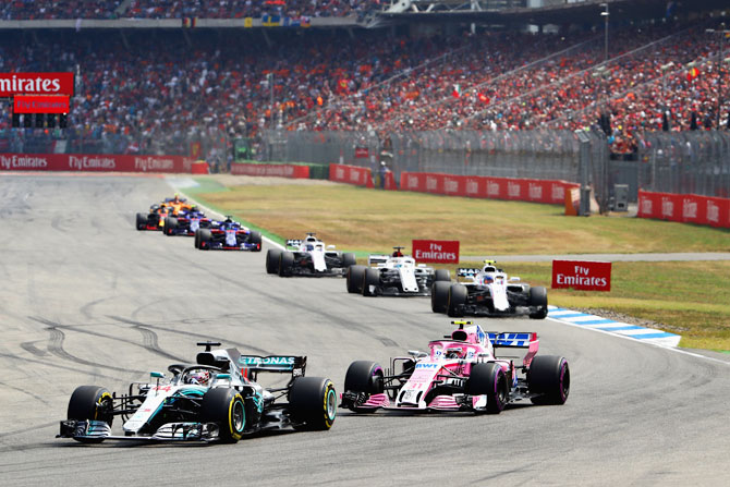 Lewis Hamilton of Great Britain driving the (44) Mercedes AMG Petronas F1 Team Mercedes WO9 leads Sergio Perez of Mexico driving the (11) Sahara Force India F1 Team VJM11 Mercedes on track during the German GP on Sunday