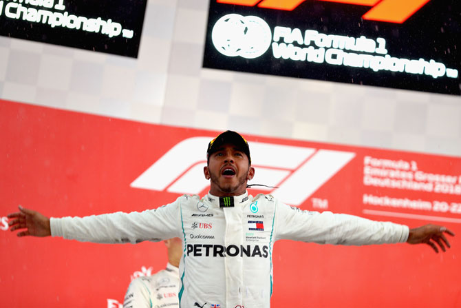 Race winner Mercedes GP's British driver Lewis Hamilton celebrates on the podium on winning the Formula One Grand Prix of Germany at Hockenheimring in Hockenheim, Germany, on Sunday