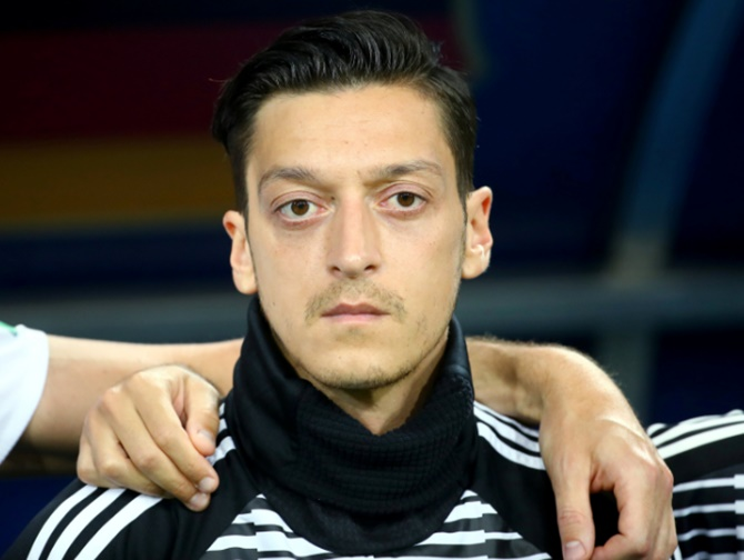 German FA boss admits mistakes in Ozil affair but rejects racism
