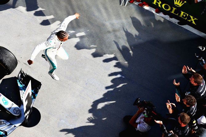 Race winner Lewis Hamilton of Great Britain and Mercedes GP celebrates in parc ferme after winning the Formula One Grand Prix of Hungary at Hungaroring in Budapest, Hungary, on Sunday
