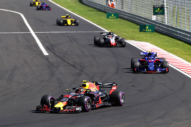 Max Verstappen of the Netherlands driving the (33) Aston Martin Red Bull Racing RB14 TAG Heuer leads Pierre Gasly of France and Scuderia Toro Rosso driving the (10) Scuderia Toro Rosso STR13 Honda on track during the Formula One Grand Prix of Hungary on Sunday