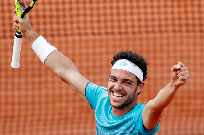 Italy's Marco Cecchinato celebrates winning his fourth round match against Belgium's David Goffin