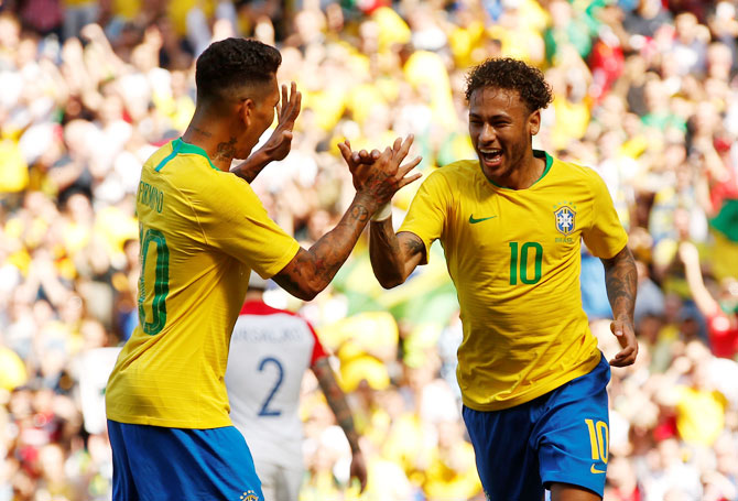 Brazil's Neymar celebrates with Roberto Firmino after scoring their first goal against Croatia during an international friendly at Anfield in Liverpool on Sunday