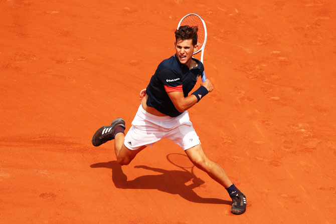 Austria's Dominic Thiem plays a forehand during his fourth round match against Japan's Kei Nishikori