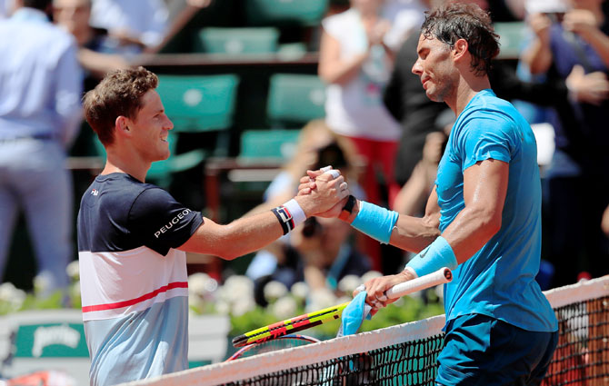 Spain's Rafael Nadal is congratulated by Argentina's Diego Schwartzman after winning their quarter-final match