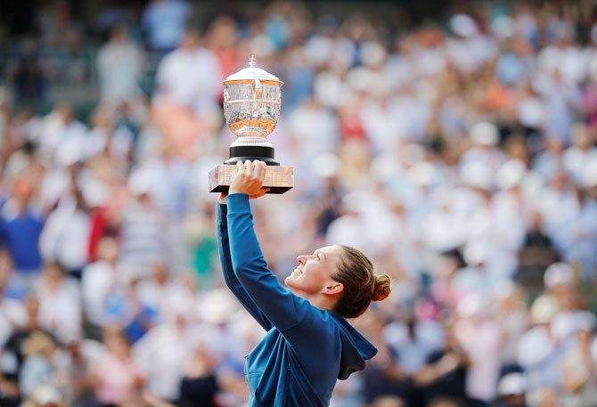 Romanian Simona Halep lifts the trophy after winning the French Open title on Saturday