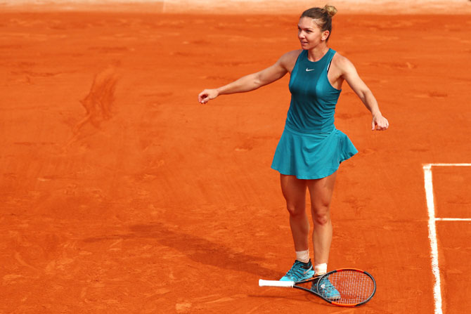 Simona Halep reacts after match point