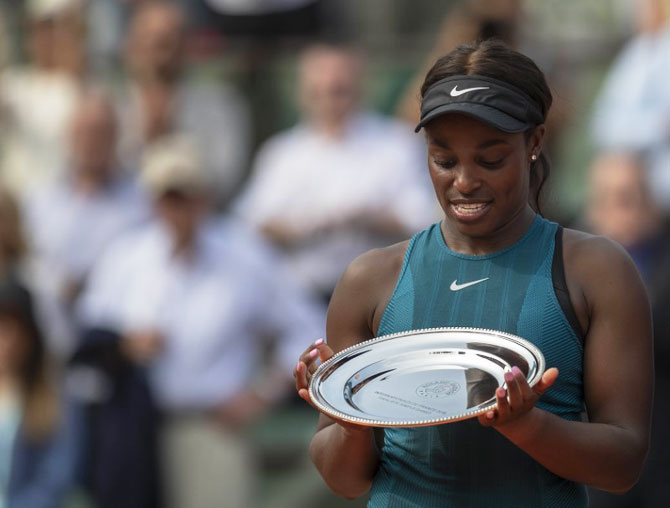 USA's Sloane Stephens with the finalist trophy after her women's final match against Romania's Simona Halep at the 2018 French Open at Roland Garros on Saturday