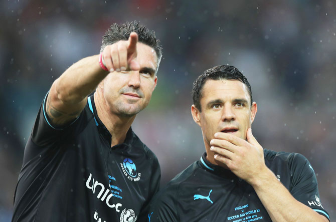 World XI's Kevin Pietersen and Dan Carter line-up prior to the Soccer Aid for UNICEF 2018 match
