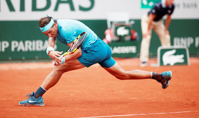 Austria's Dominic Thiem hits the ball long for Spain's Rafael Nadal to win the final