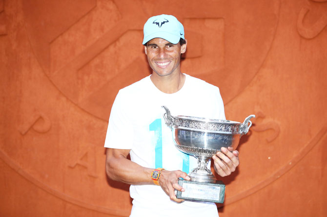 Spain's Rafael Nadal poses with the Musketeers' Cup following his French Open victory over Austria's Dominic Thiem at Roland Garros in Paris on Sunday