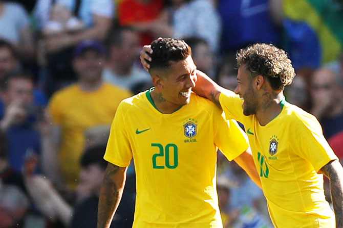 Brazil's Roberto Firmino and Neymar celebrate a goal. Brazil begin their campaign against Switzerland on Sunday