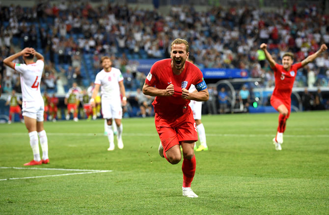 England's Captain Harry Kane celebrates after scoring the winner in the game against Tunisia. Photograph: Matthias Hangst/Getty Images